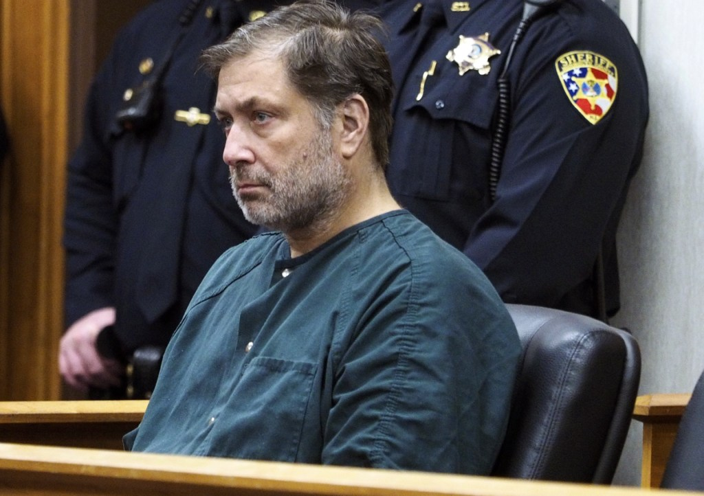 Paul Caneiro appears in Monmouth County Superior Court for a detention hearing on Friday in Freehold, N.J. Caneiro, 51, faces four counts of murder, along with arson and weapons charges, in the deaths of his brother Keith; Keith's wife, Jennifer; their 11-year-old son, Jesse; and their 8-year-old daughter, Sophia.