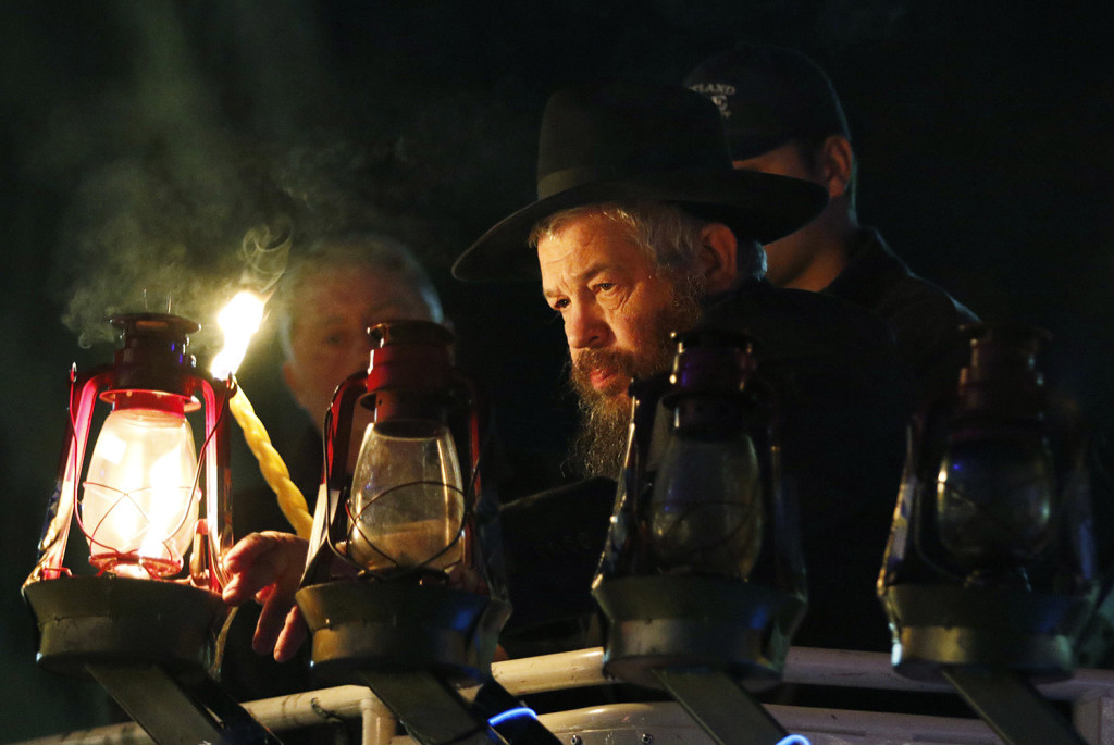 Rabbi Moshe Wilansky lights the Menorah in front of Portland City Hall on Dec. 6, 2015. Portland will begin this year's observation of Hanukkah festivities at 5 p.m. Sunday on the steps of City Hall.