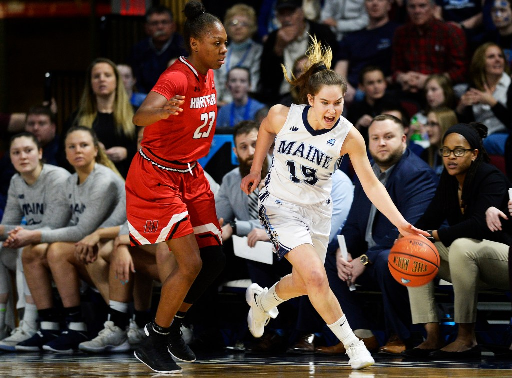 BANGOR, ME - MARCH 9: Maine's Dor Saar drives past Alexia Douglas of Hartford Friday, March 9, 2018. (Staff photo by Shawn Patrick Ouellette/Staff Photographer)