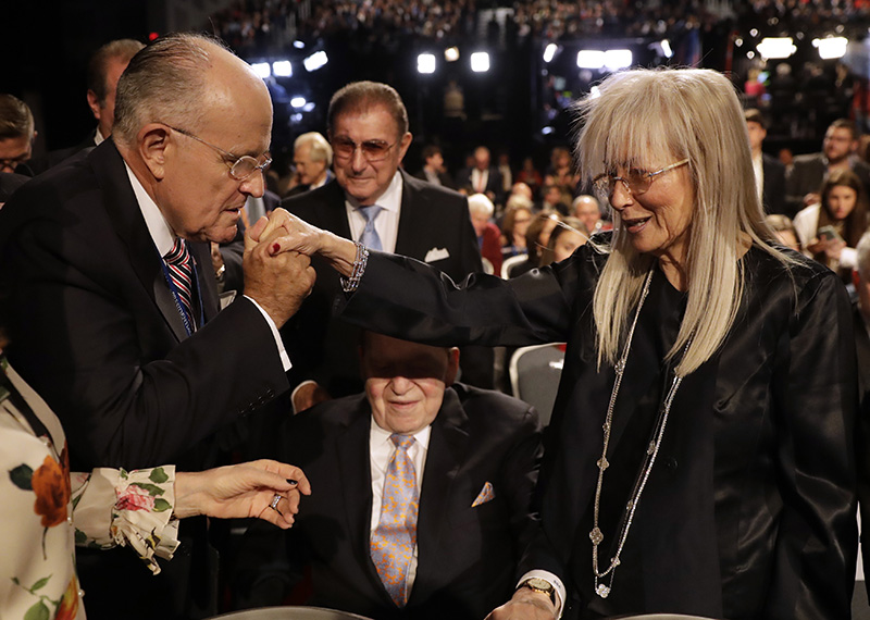 Former mayor of New York City Rudy Giuliani, kisses Miriam Adelson's hand at a presidential debate between Democrat Hillary Clinton and Republican Donald Trump in Hempstead, N.Y. in 2016.