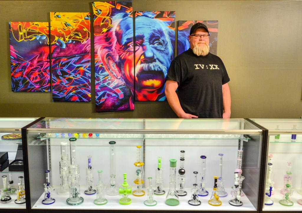 Owner-operator Derek Wilson poses for a portrait Thursday in The Cannabis Healing Center in Hallowell.