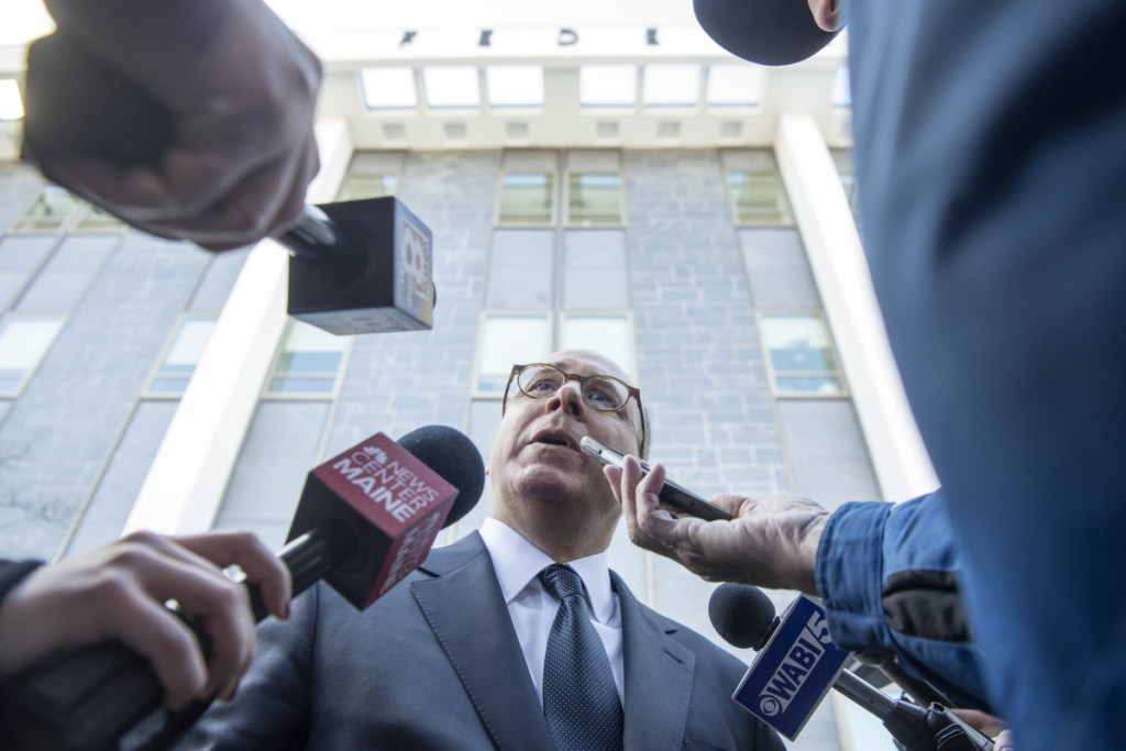 Lee Goodman, center, attorney for Rep. Bruce Poliquin, speaks to the media after a Nov. 13 hearing at the U.S. District Court in Bangor on ranked-choice voting in the 2nd Congressional District race. Staff photo by Michael G. Seamans