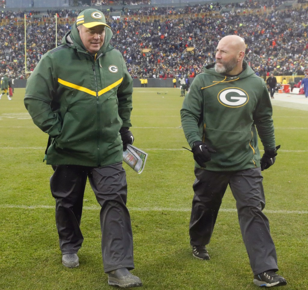 Mike McCarthy, left, leaves the field Sunday for the final time as the Green Bay Packers' coach, following a loss to the Arizona Cardinals.