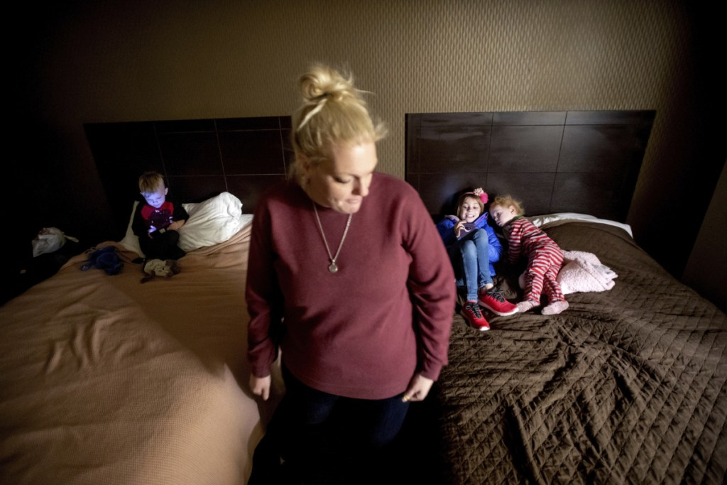 Erica Hall pauses Monday in Yuba City, Calif., while preparing her children for their first day of school since the Camp Fire destroyed their home. The family, who lost their five-bedroom home in Paradise, Calif., plans to stay in a hotel room through February.