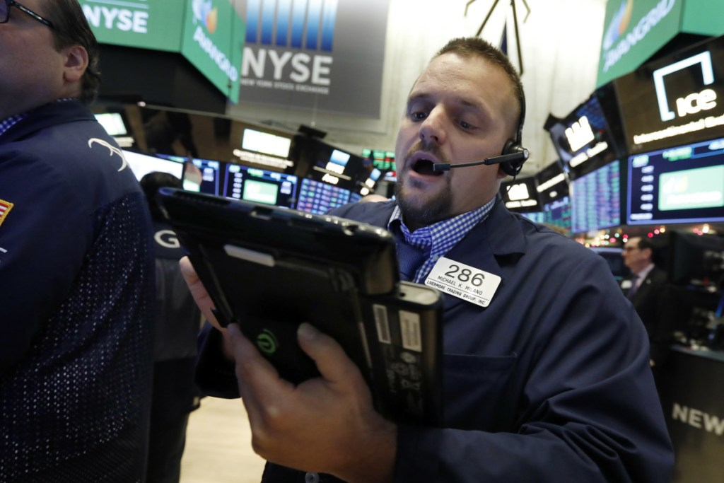 Trader Michael Milano works on the floor of the New York Stock Exchange last month. Stocks were turning sharply lower on Tuesday.
