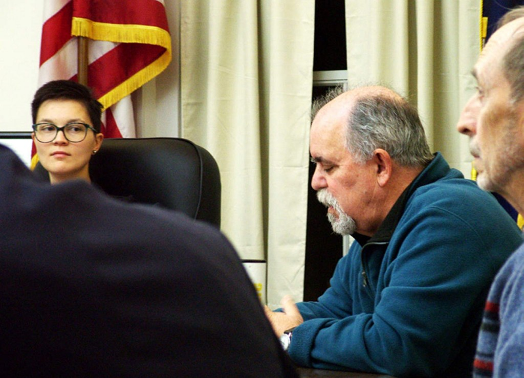 Belfast Mayor Samantha Paradis glances at City Councilor Mike Hurley, second from right, as elected officials met Tuesday to try to patch up differences.