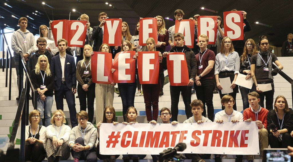 Polish teenagers protest at the U.N. climate summit in Katowice, Poland, on Friday to urge negotiators from almost 200 countries to reach an agreement on ways of keeping global warming in check.