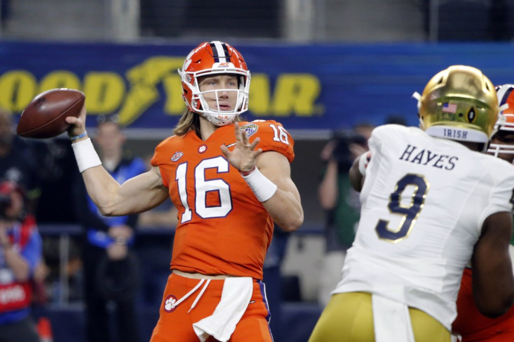 Clemson quarterback Trevor Lawrence threw for 327 yards and three touchdowns to lead the Tigers over Notre Dame on Saturday in Arlington, Texas.