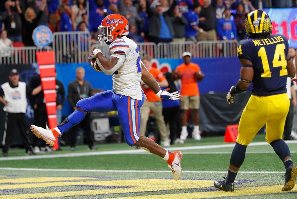 Florida running back Lamical Perine (22) runs into the end zone for a touchdown against Michigan during the first half of the Peach Bowl on Saturday in Atlanta.