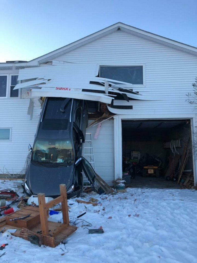 This SUV burst through the back wall of a garage Monday afternoon at a home at 100 Town Farm Road in Hallowell.