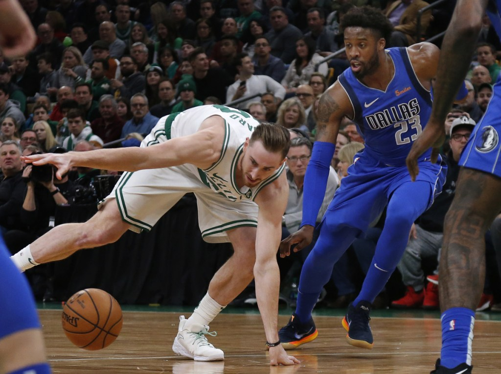 Celtics forward Gordon Hayward loses control of the ball while being defended by Mavericks guard Wesley Matthews during the Celtics' 114-93 win Friday in Boston. Hayward had 16 points, 11 rebounds and eight assists.