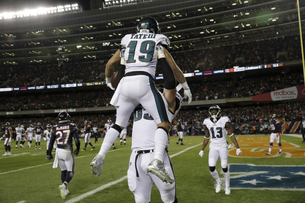Eagles receiver Golden Tate is hoisted by offensive tackle Lane Johnson after catching the go-ahead touchdown pass with less than a minute remaining Sunday, lifting Philadelphia to a 16-15 win over the Chicago Bears.