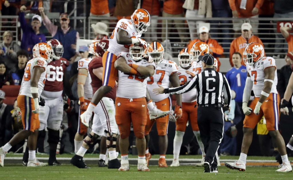 The Clemson defense celebrates after stopping Alabama during the second half of the Tigers' 44-16 win in the College Football Playoff national championship game on Monday in Santa Clara, California.