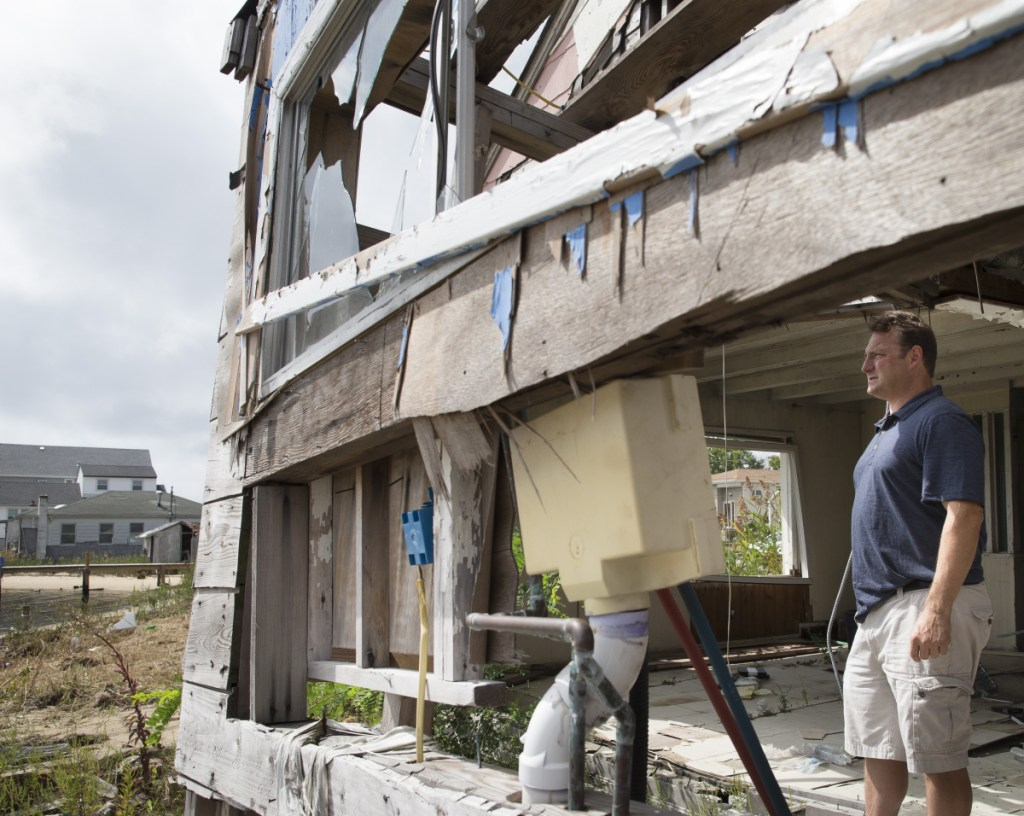 Gary Silberman surveys the damage from his parents' home in Lindenhurst, N.Y., in 2014 after Hurricane Sandy. Technically, Sandy wasn't even a hurricane when it made landfall in New Jersey.