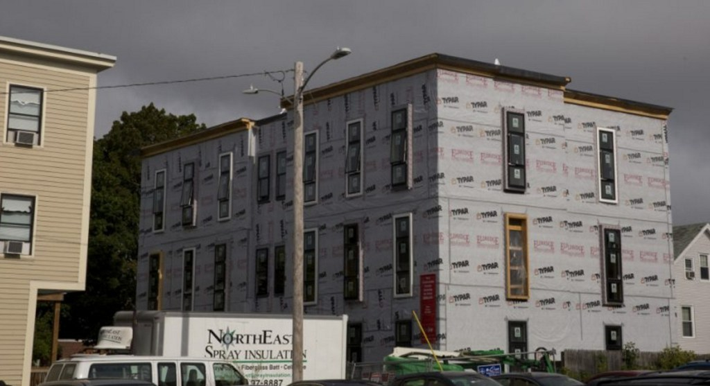 The Onejoy project, a 12-unit condo building under construction in Portland's West End last fall. A unit in the development is being set aside as affordable housing for a middle-income family.