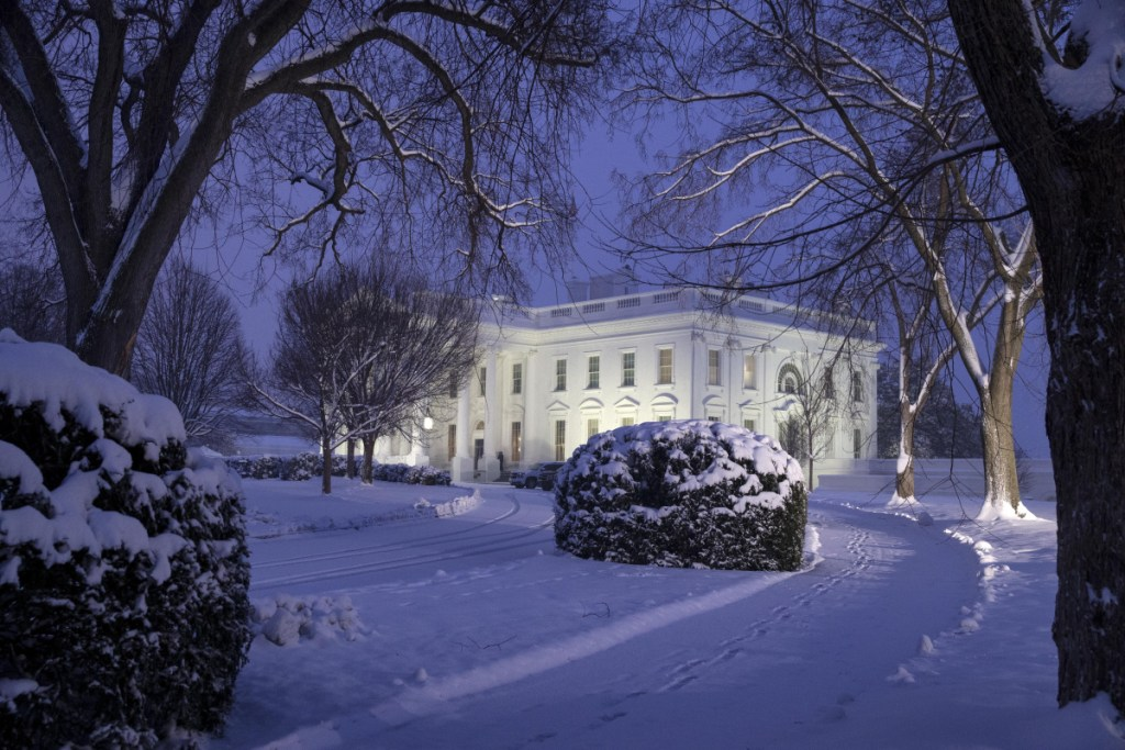 The White House is seen as snow continues to fall Sunday in Washington. (AP Photo/Alex Brandon)