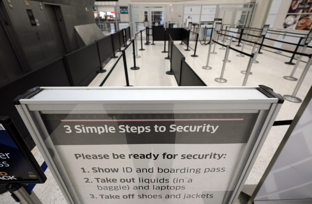 Security checkpoint lanes remain empty inside Terminal B at George Bush Intercontinental Airport on Tuesday in Houston. The checkpoint has been closed for several days due to staffing issues. The partial government shutdown is starting to strain the national aviation system, with unpaid security screeners staying home, air-traffic controllers suing the government and safety inspectors off the job.