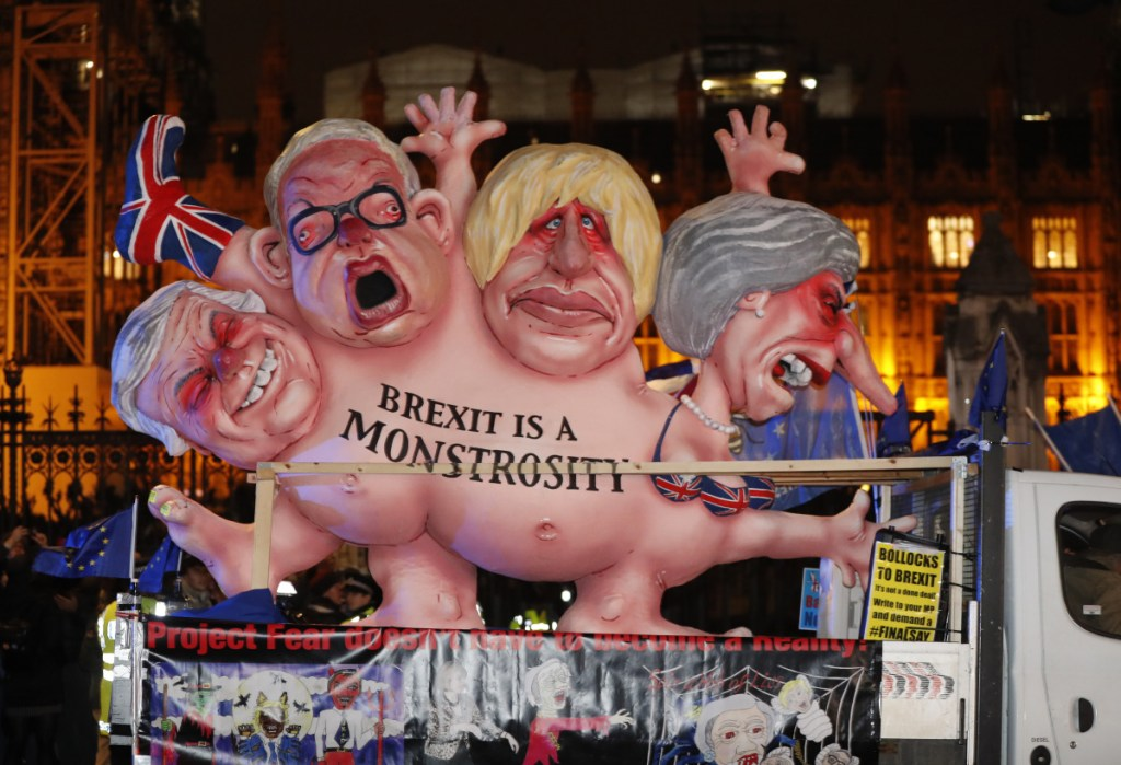 An anti-Brexit effigy is driven around Parliament square in London on Tuesday after the House of Commons rejected the Brexit deal struck between Britain's government and the EU in November.