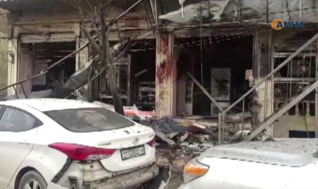 This image from video provided by Hawar News, ANHA, the news agency for the semi-autonomous Kurdish areas in Syria, shows a damaged restaurant where an explosion occurred in Manbij, Syria, on Wednesday.