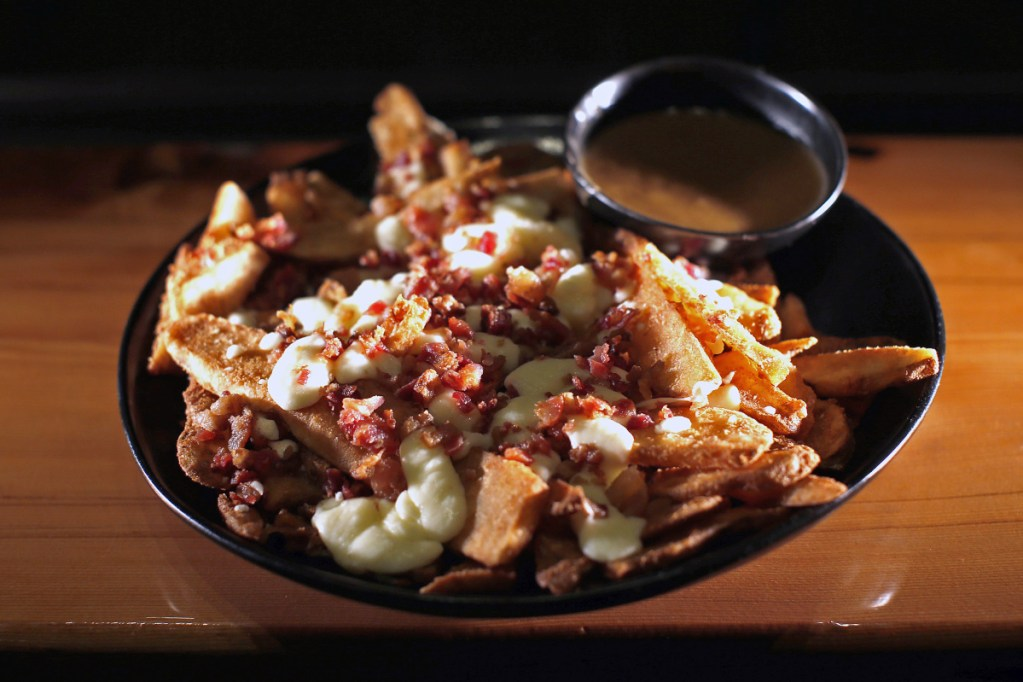 Bacon Poutine is an example of a dish of mixed provenance that's above average.