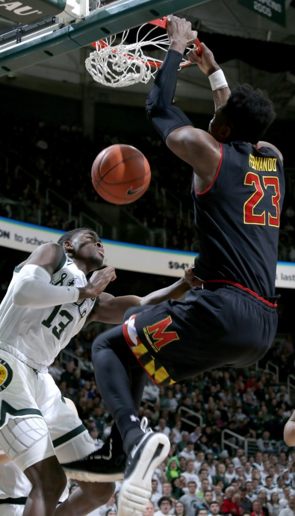 Bruno Fernando of Maryland dunks on Gabe Brown of Michigan State during Michigan State's 69-55 victory Monday.