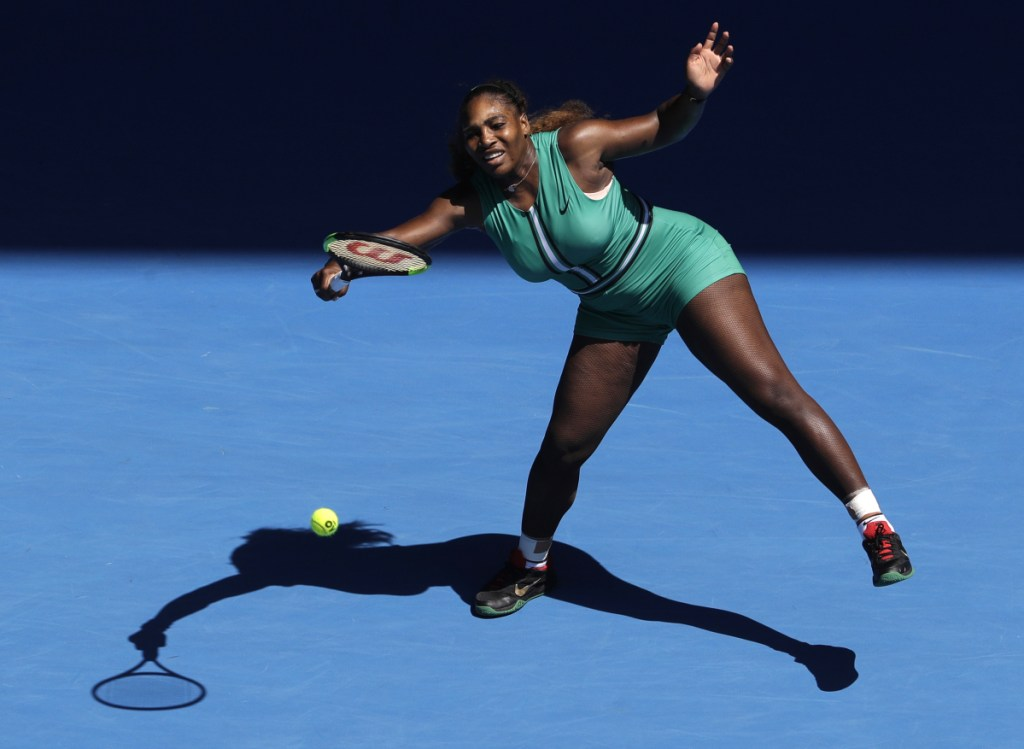 Serena Williams hits a forehand return to Karolina Pliskova of the Czech Republic during their quarterfinal match at the Australian Open.