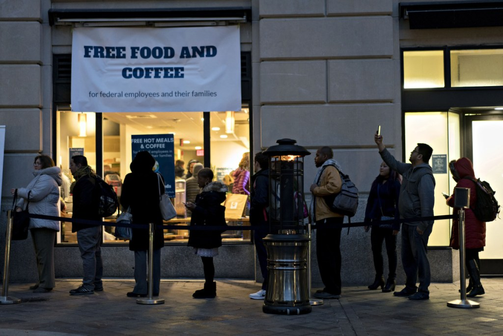 Customers wait in line outside a restaurant opened by chef Jose Andres for federal workers and their families during a partial government shutdown in Washington, D.C.