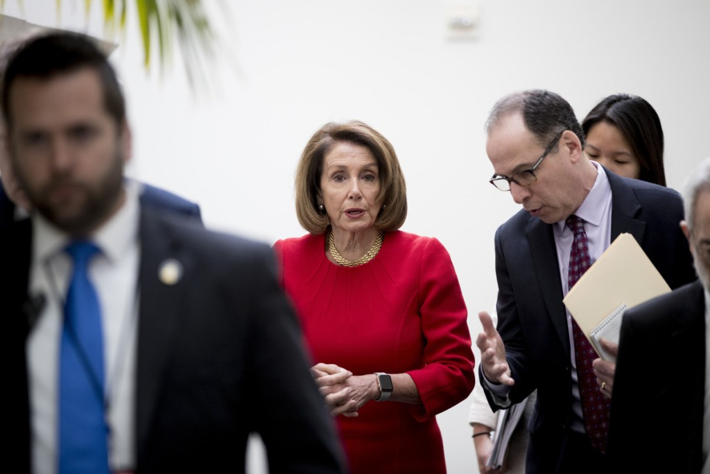 House Speaker Nancy Pelosi of California leaves a House Democratic Caucus meeting on Capitol Hill in Washington on Wednesday. She officially informed President Trump that the House would not authorize his appearance to deliver his State of the Union until the partial government shutdown ends.