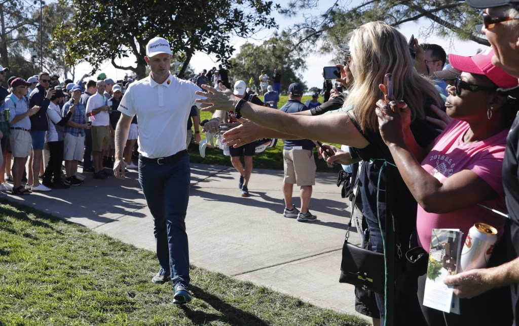 Justin Rose greets the crowd on his way to the seventh hole Saturday during the third round of the Farmers Insurance Open in San Diego.