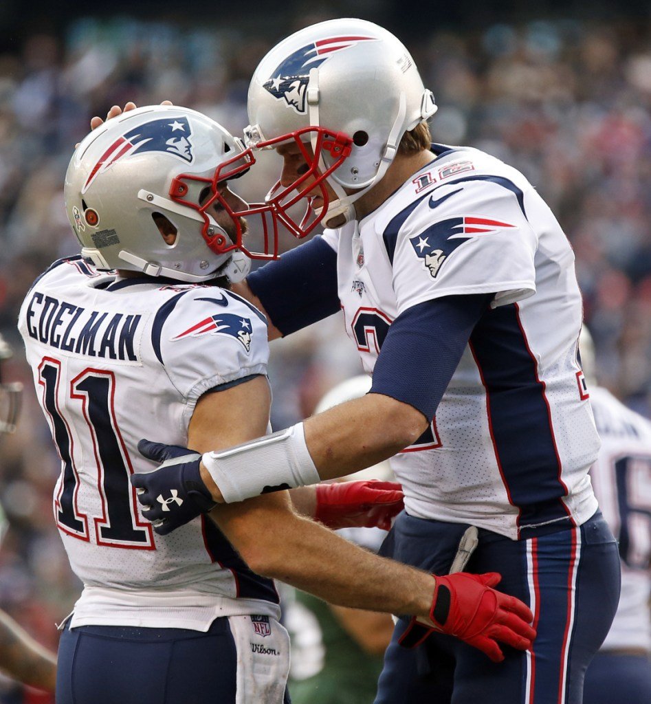Tom Brady and Julian Edelman celebrating a playoff TD. Yup, it's happened a lot as they share a tight connection that has produced many memorable times for the Patriots.