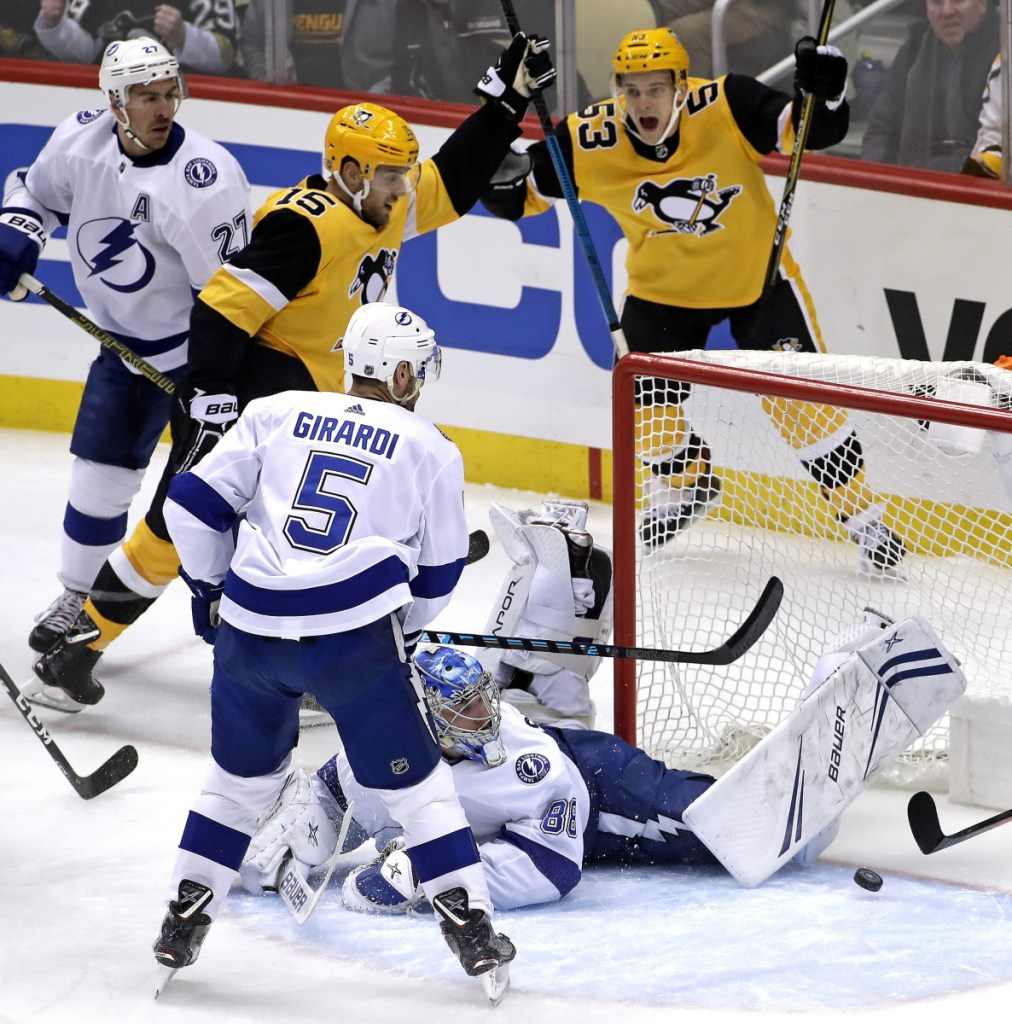 Pittsburgh's Riley Sheahan celebrates his goal past sprawling Tampa Bay goaltender Andrei Vasilevskiy with Teddy Blueger during the first period Wednesday night at Pittsburgh.