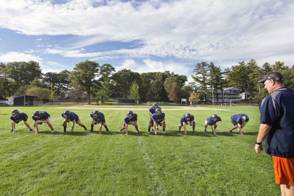 Traip Academy's junior varsity football team runs through a drill in Kittery in 2017. Advocates of eight-man football hope it helps some Maine high schools that struggle with participation to keep their programs afloat.