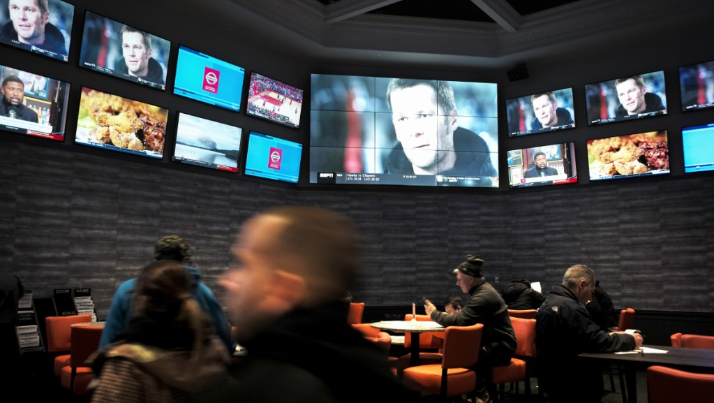 Patrons mill about at the sports betting area of Twin River Casino in Lincoln, R.I., but expect the crowds to be thick on Sunday when fans of the New England Patriots can place legal bets on the Super Bowl.