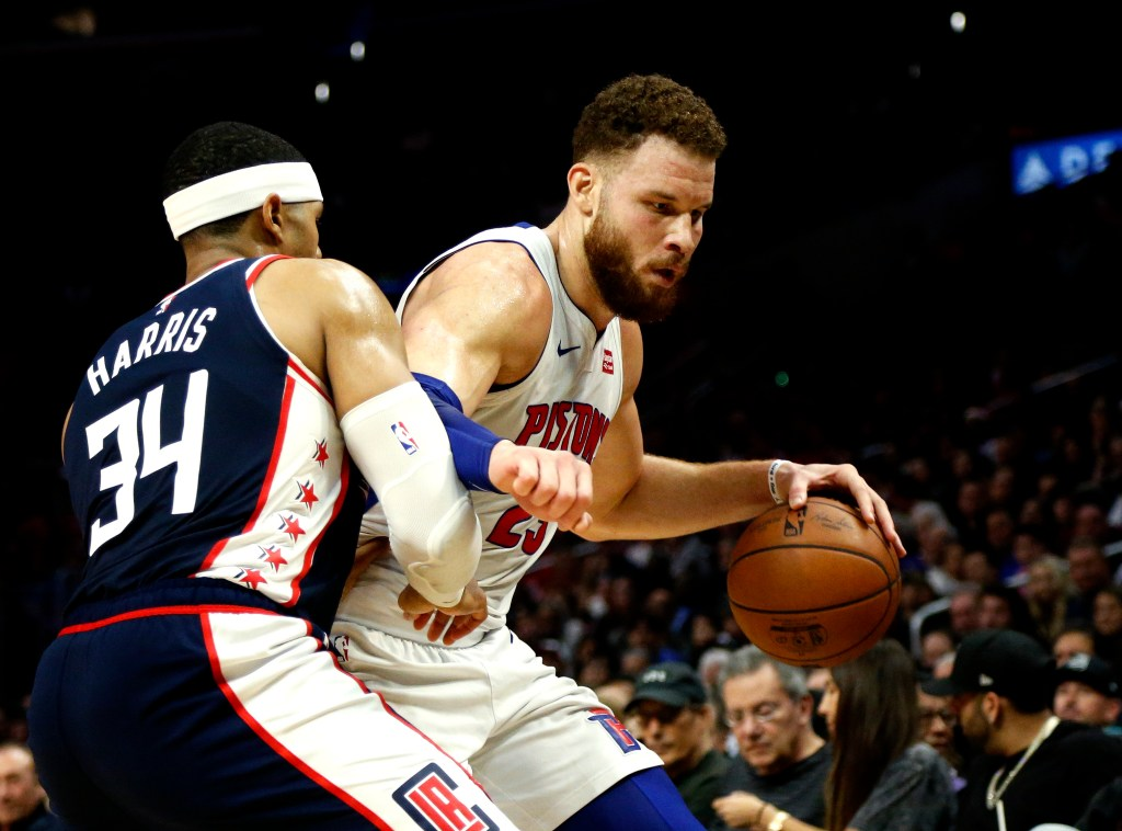 Detroit's Blake Griffin makes a move to the hoop while being guarded by the Clippers' Tobias Harris during the Pistons' 109-104 win Saturday in Los Angeles.