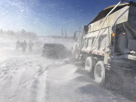 Heavy winds caused whiteout conditions on Route 1 in Cyr Plantation on Tuesday at the scene of an 11-vehicle crash that resulted in several injuries.