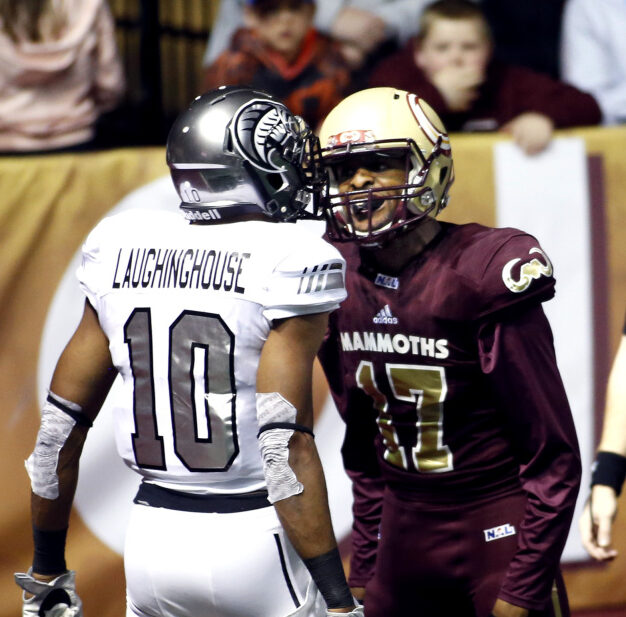 Tevin Creeks of Maine Mammoths talks to Tyrone Laughinghouse of Carolina after breaking up a pass during the Mammoth's home opener on April 14, 2018. The Mammoth's won't play in 2019 as a local owner is sought.