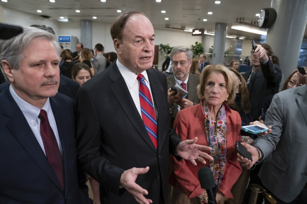 Sen. Richard Shelby, R-Ala., the top Republican on the bipartisan group of negotiators working to craft a border security compromise in hope of avoiding another government shutdown, is joined by Sen. John Hoeven, R-N.D., left, and Sen. Shelley Moore Capito, R-W.Va., right, as they speak with reporters after a briefing with officials about the U.S.-Mexico border, on Capitol Hill in Washington on Wednesday.