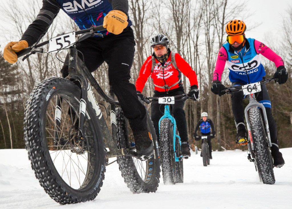 George Lowe, left, of Lyndonville, Vt.; David Anderson, center, of Waterboro; and Alan Pimentel of Gray are among the competitors in a fat bike race in Bethel.