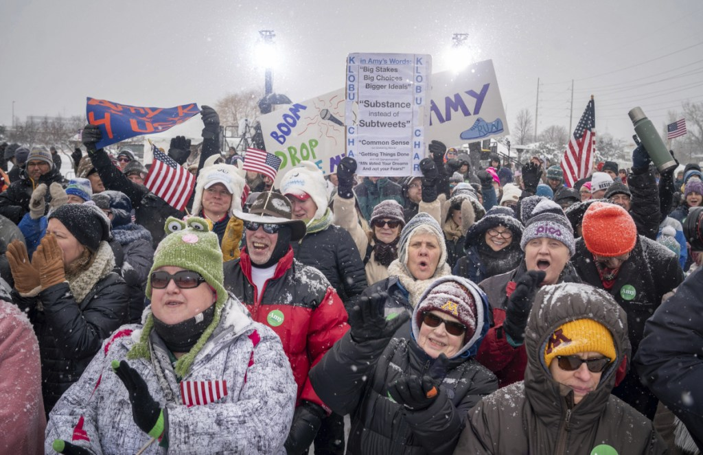 Klobuchar supporters cheer as a DJ takes the stage in a snowy Boom Park in Minneapolis.