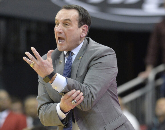 Duke Coach Mike Krzyzewski argues a call during the second half of Tuesday's game against Louisville in Louisville, Ky. Duke won 71-69.
