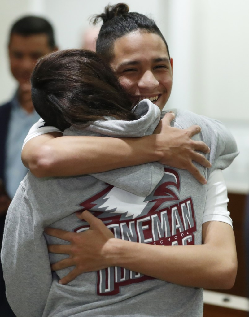Anthony Borges, rear, who was shot during the Parkland, Fla., school shooting, hugs Marianne Sheehan after a news conference with Florida governor Ron DeSantis on Wednesday.