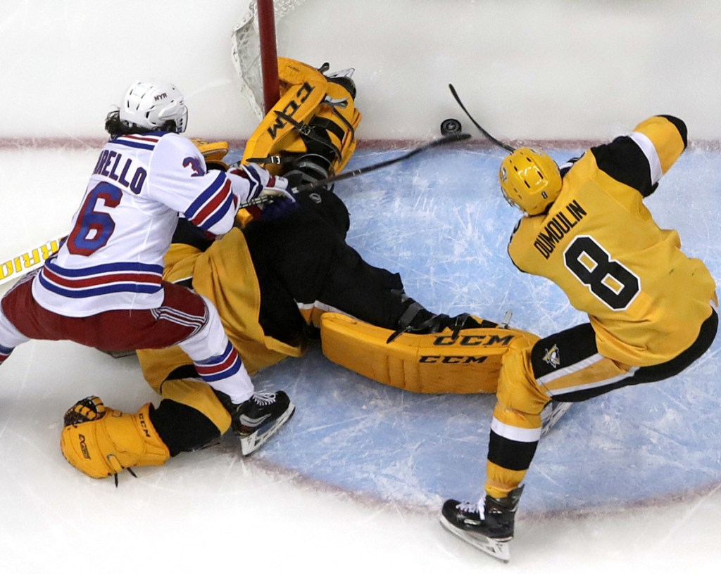 The Rangers' Mats Zuccarello pokes the puck across the goal line during the second period Sunday in Pittsburgh. The Penguins held on for a 6-5 win.