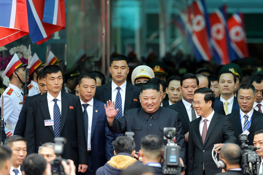 North Korean leader Kim Jong Un waves upon his arrival by train Tuesday in Dong Dang, a Vietnamese border town, before his second summit with President Trump.