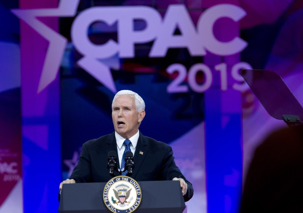"""Vice President Mike Pence speaks at the Conservative Political Action Conference in Oxon Hill, Md., on Friday. """"The moment America becomes a socialist country is the moment America ceases to be America,"""" he told the crowd of conservative activists."""