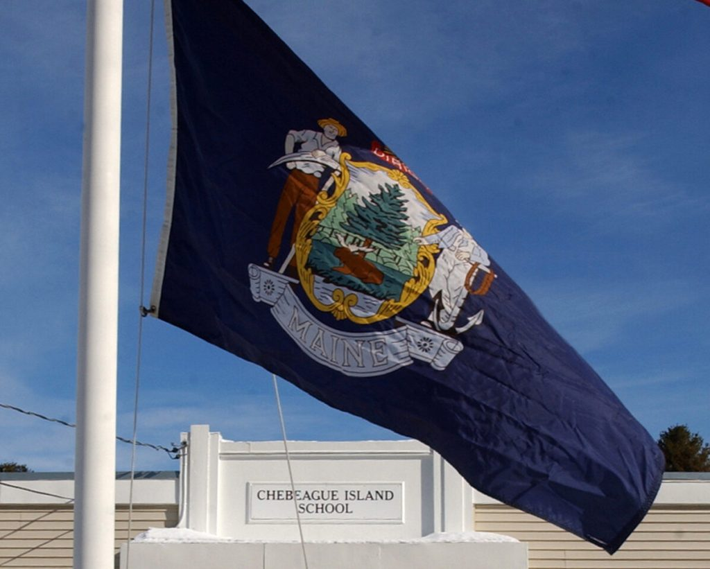 The current Maine state flag is rich in references to the state's natural beauty and industry.
