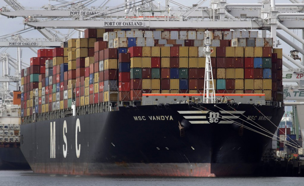 A container ship is unloaded at the Port of Oakland in Oakland, Calif., in January. The U.S. trade deficit continues to hit record highs despite President Trump's intervention through tariffs.