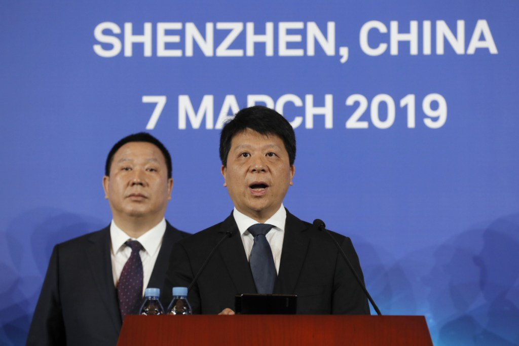 """Huawei Rotating Chairman Guo Ping, center, appeared at a press conference Thursday in Shenzhen, China, as the company launched a lawsuit in Plano, Texas, the headquarters of Huawei's U.S. operations. Guo said the company was """"compelled to take this legal action"""" to protect its position in the global marketplace. Associated Press/Kin Cheung"""