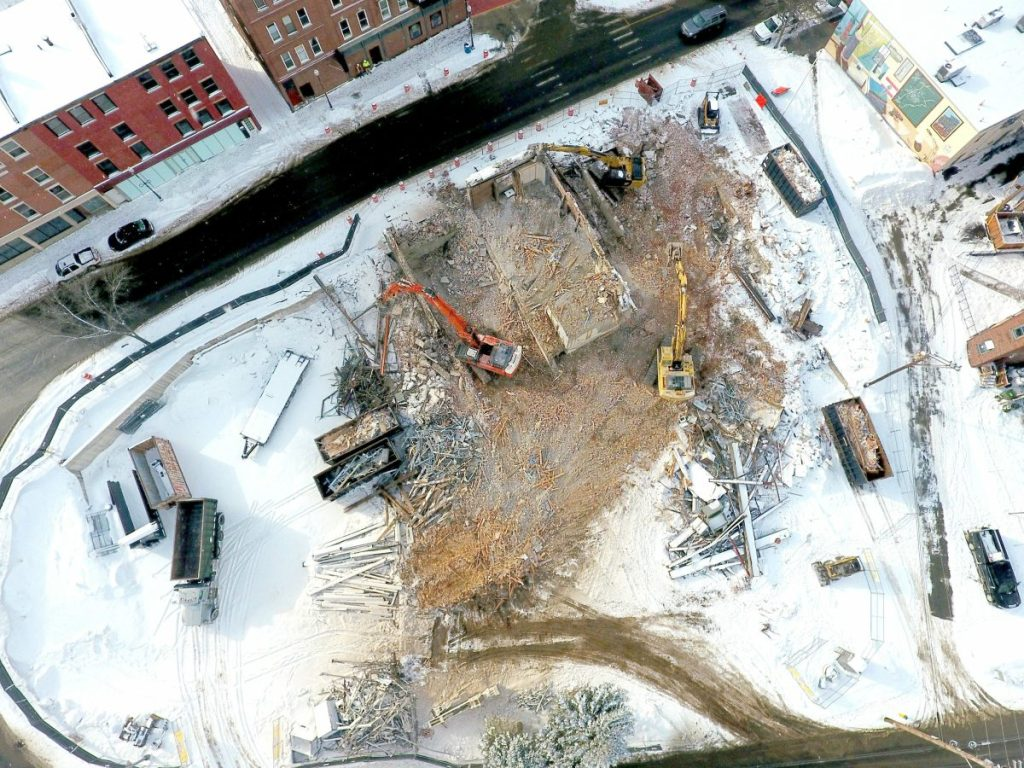 Excavator operators finish demolishing the former Camden National Bank in downtown Waterville in February to make room for the planned Colby College hotel at the end of Main Street.