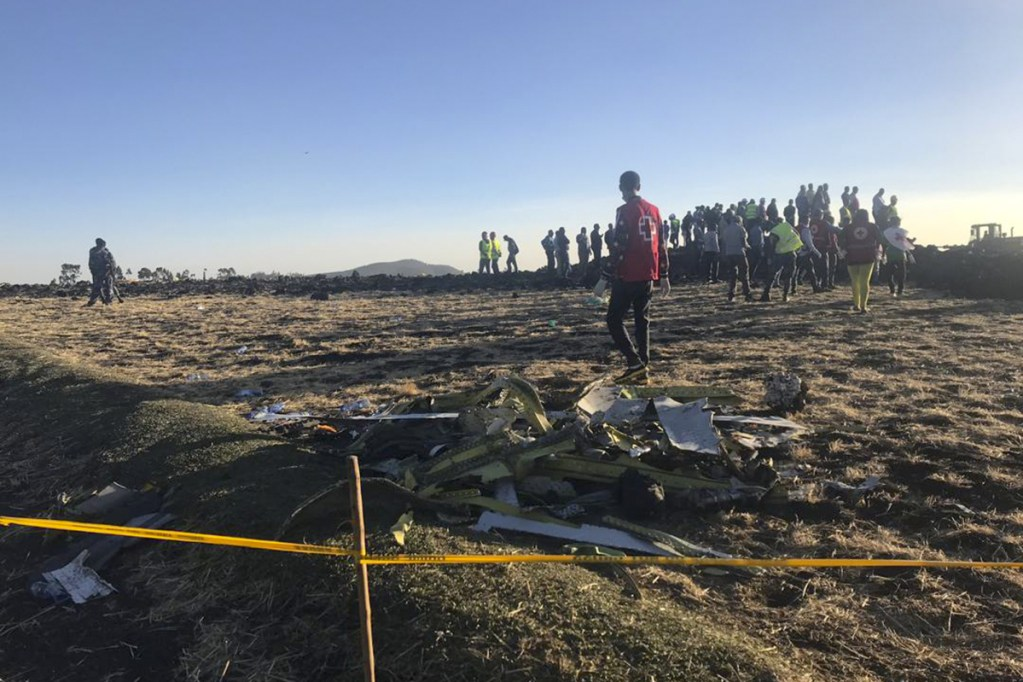 Rescuers search at the scene of an Ethiopian Airlines flight that crashed shortly after takeoff at the scene at Hejere near Bishoftu, or Debre Zeit, some 31 miles south of Addis Ababa Sunday.
