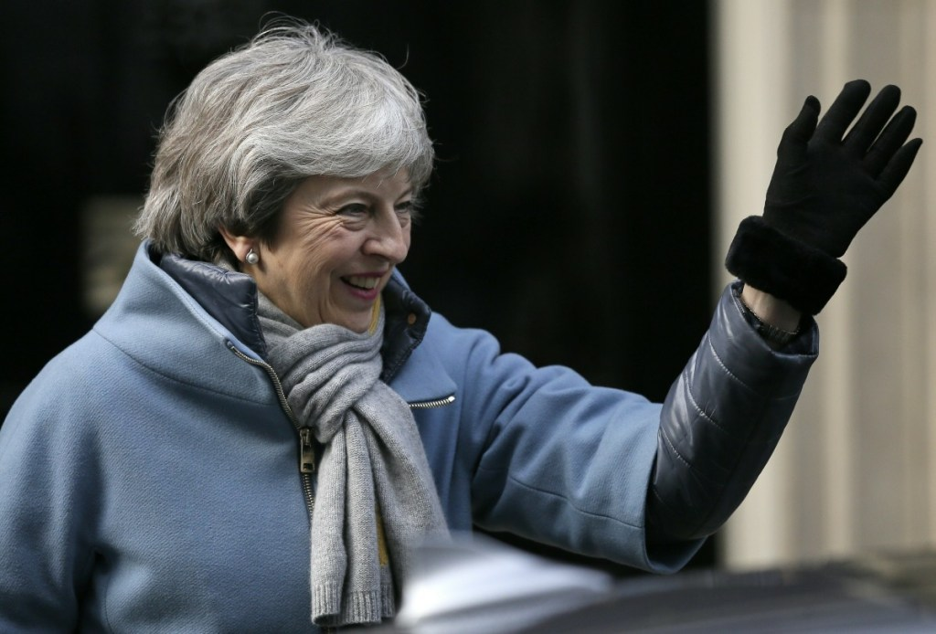 Britain's Prime Minister Theresa May leaves 10 Downing street in London on Thursday, when British lawmakers faced another tumultuous day dealing with the country's scheduled departure from the European Union and May struggled to shore up her shattered authority.